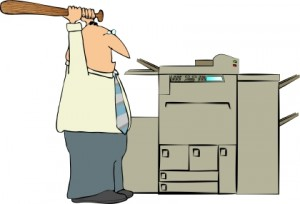 Man-Beating-a-Copy-Machine2-300x204